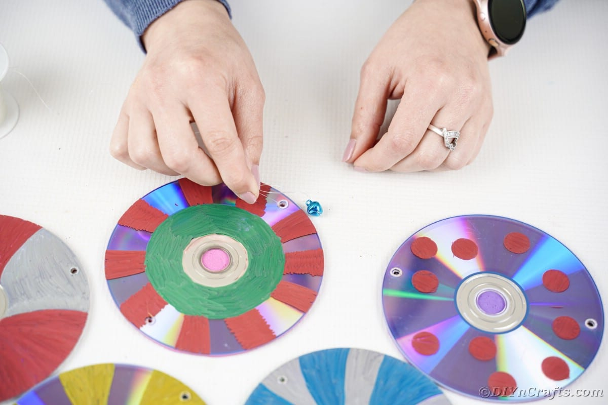 Attaching a bell to painted CDs