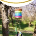 Pinterest image of wind chime outside with pink and black text