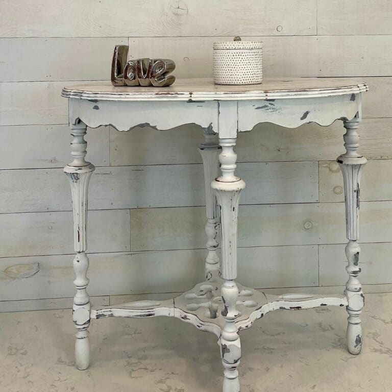 White and grey distressed end table with love sign and candle on top