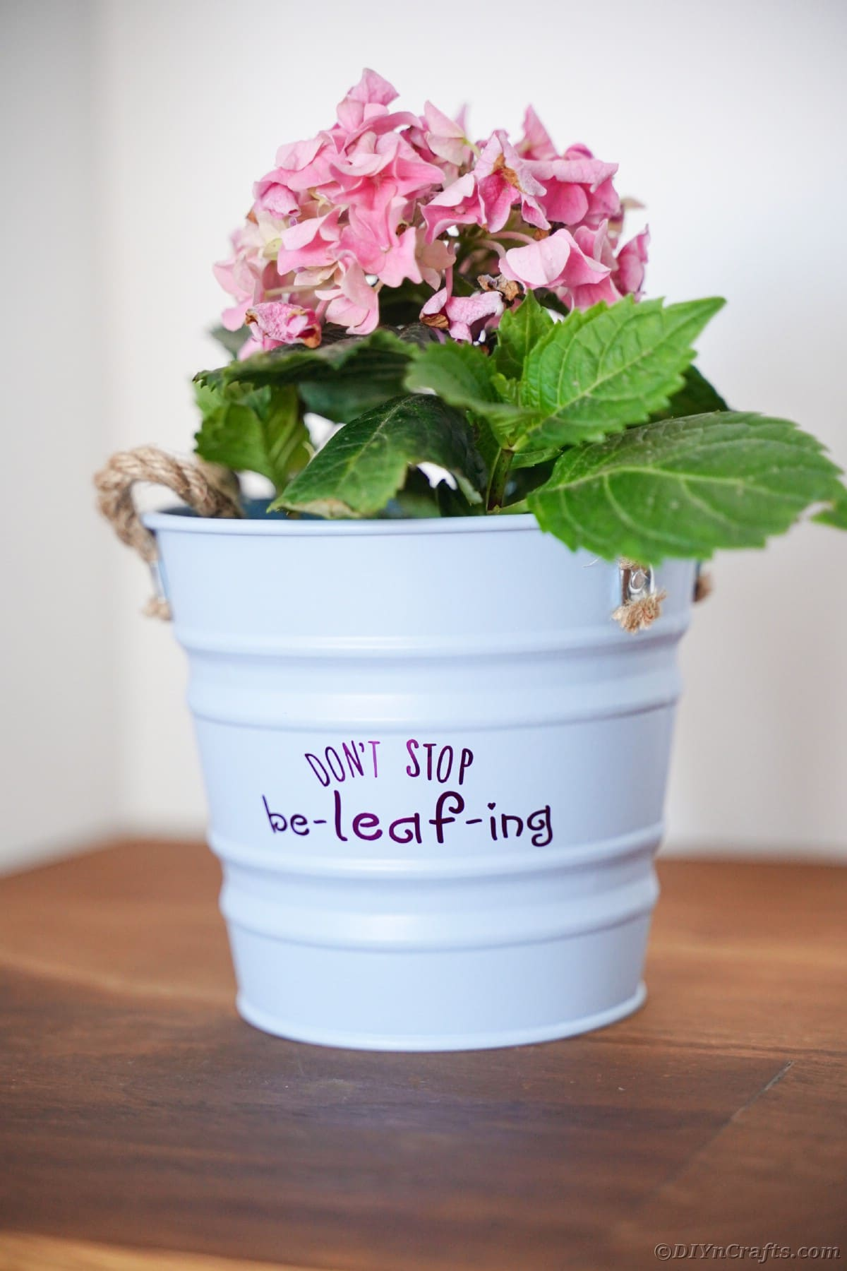 White bucket with purple message on table