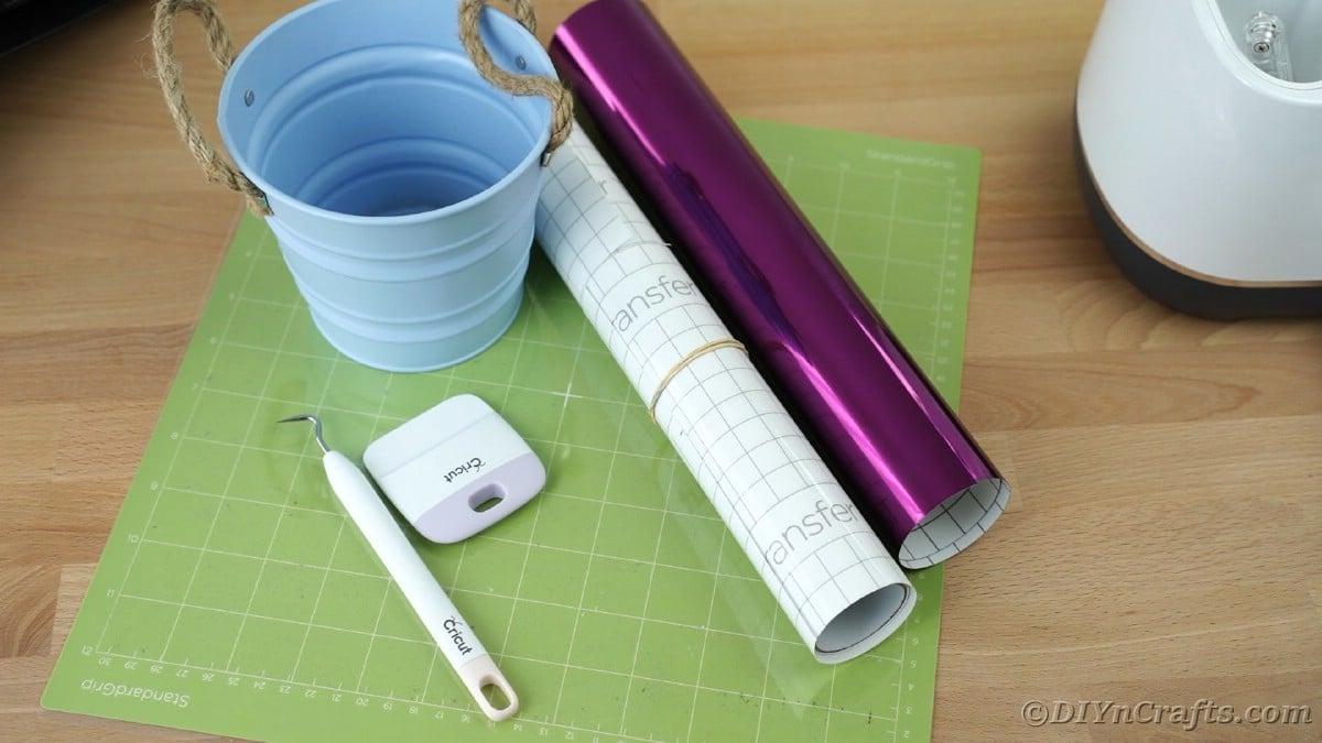 Roll of purple vinyl on cricut mat