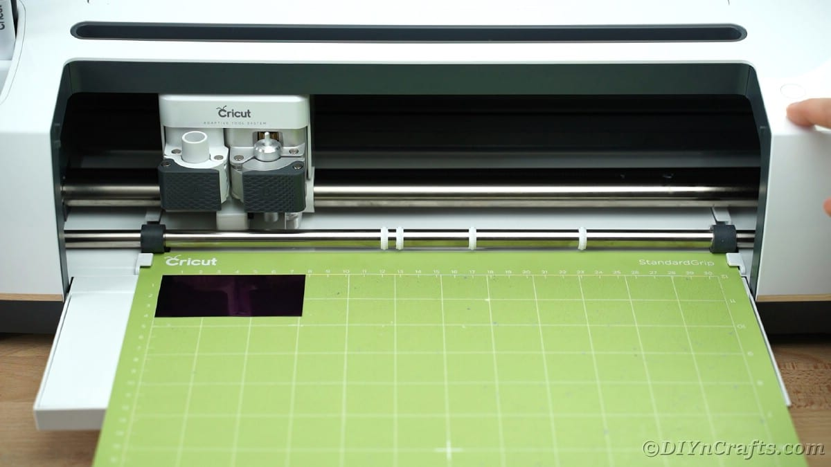 Cricut mat loading into cricut maker