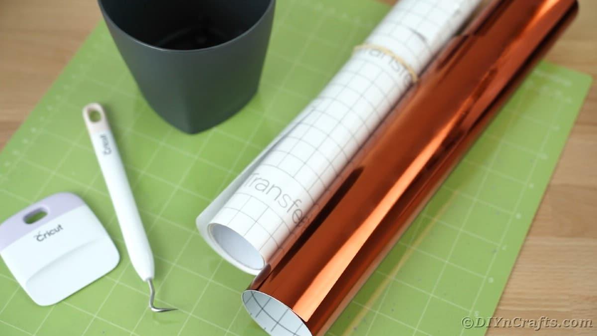 Orange vinyl on green Cricut mat