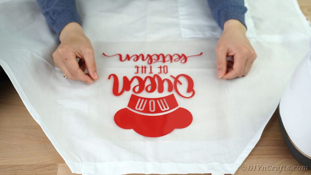 Placing vinyl onto center of apron