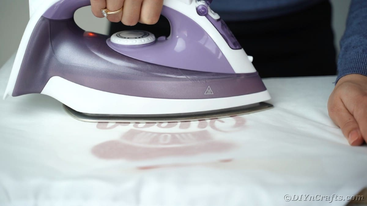 Ironing vinyl onto apron