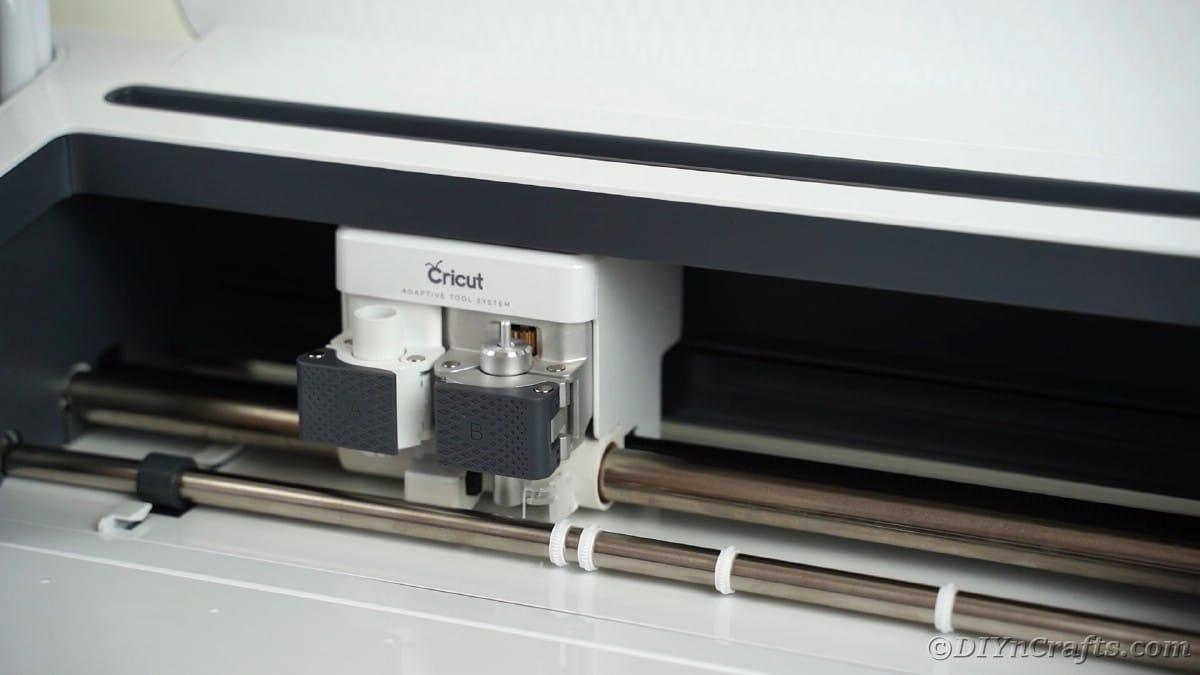 Loading blade into Cricut machine
