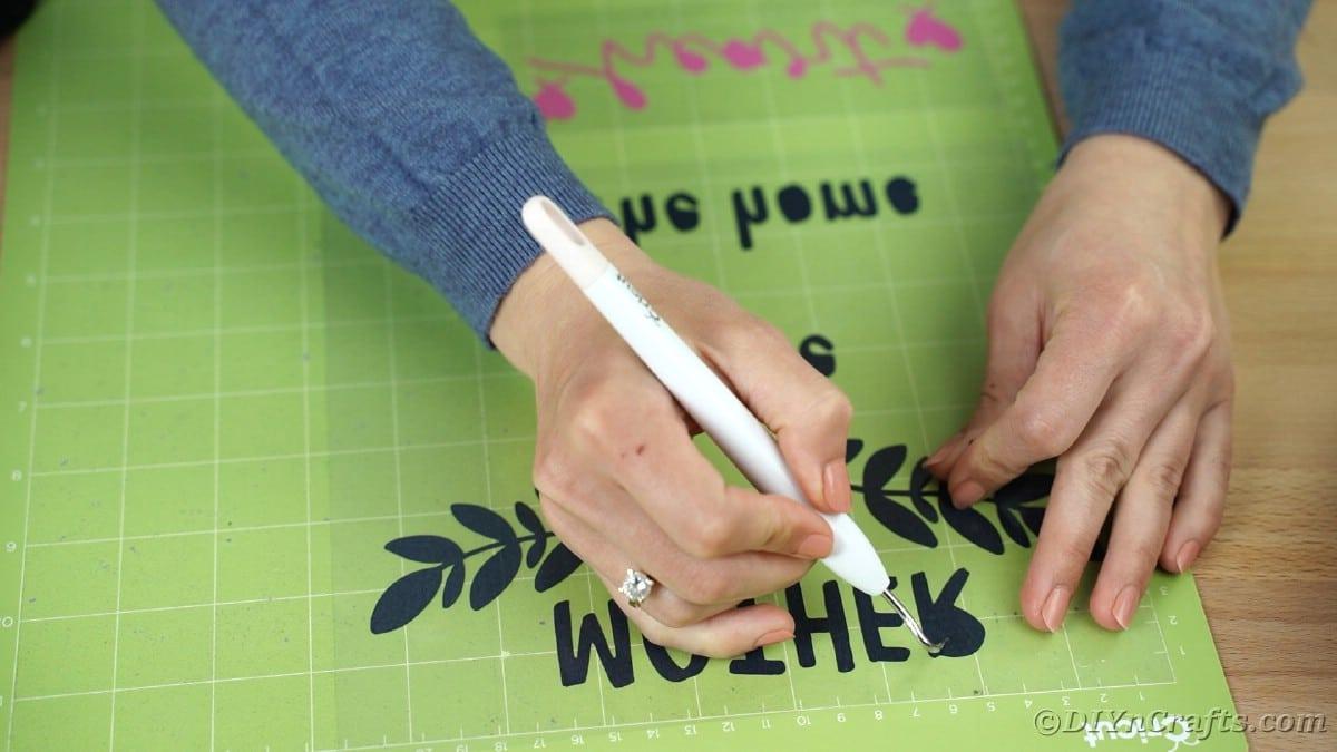 Weeding vinyl on Cricut mat