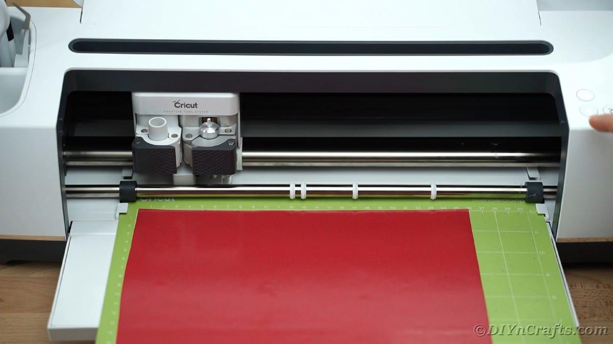 Loading Cricut mat into Cricut maker machine