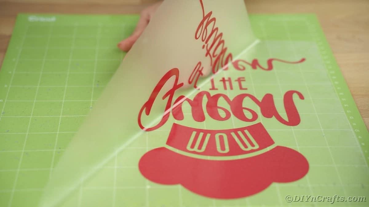 Peeling vinyl off mat on transfer tape