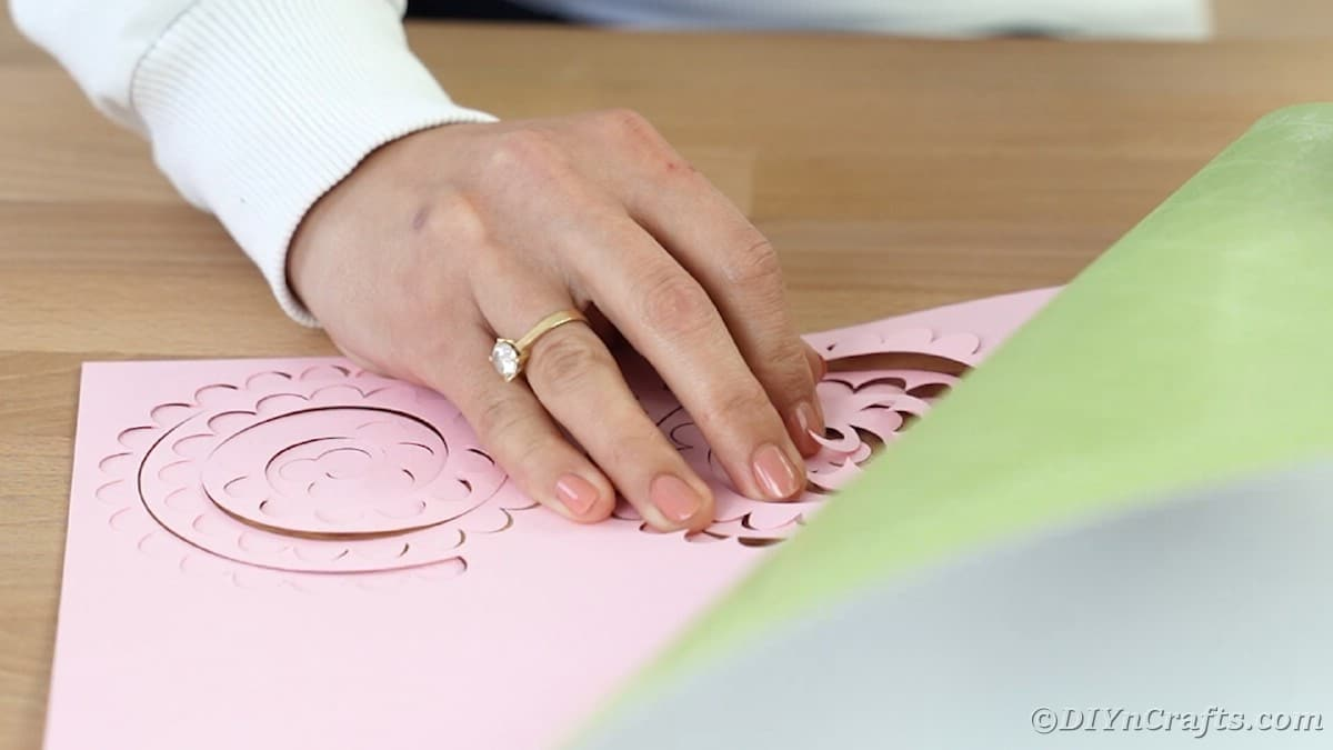 Peeling pink flowers from Cricut mat