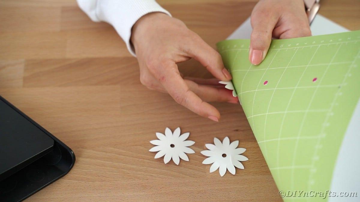 Peeling flowers off green Cricut mat