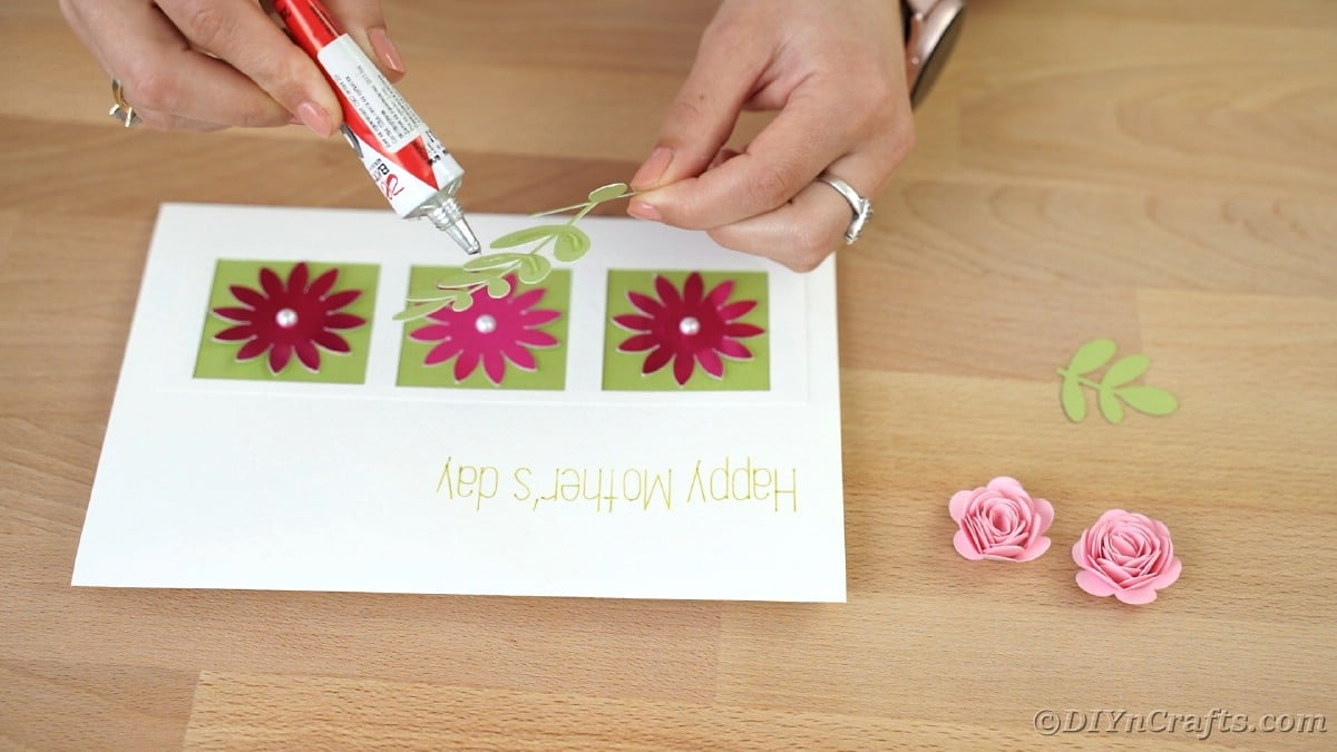 Gluing leaves onto card