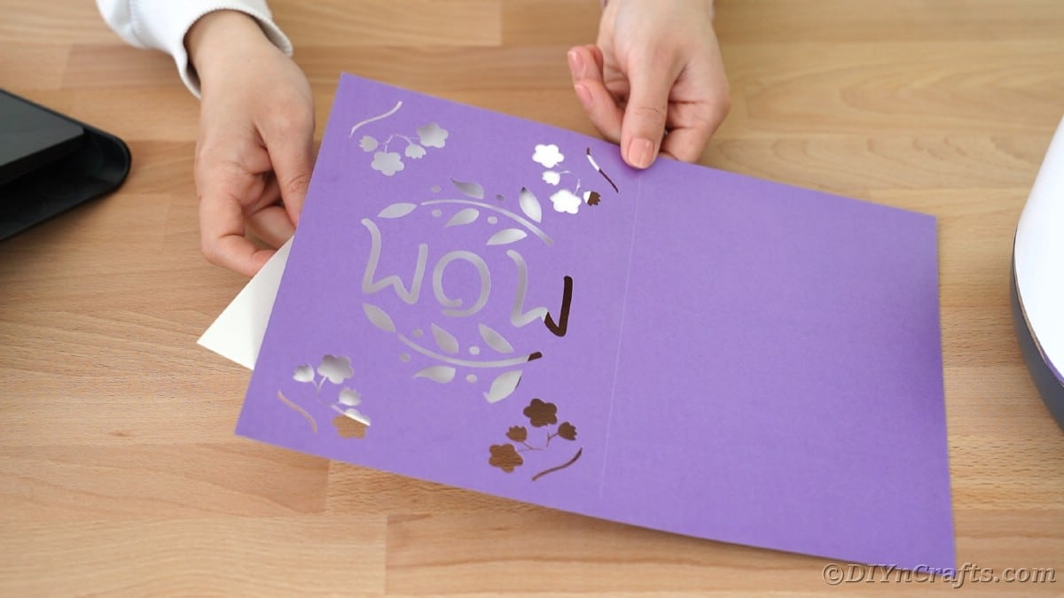 Adding white paper on back of purple card