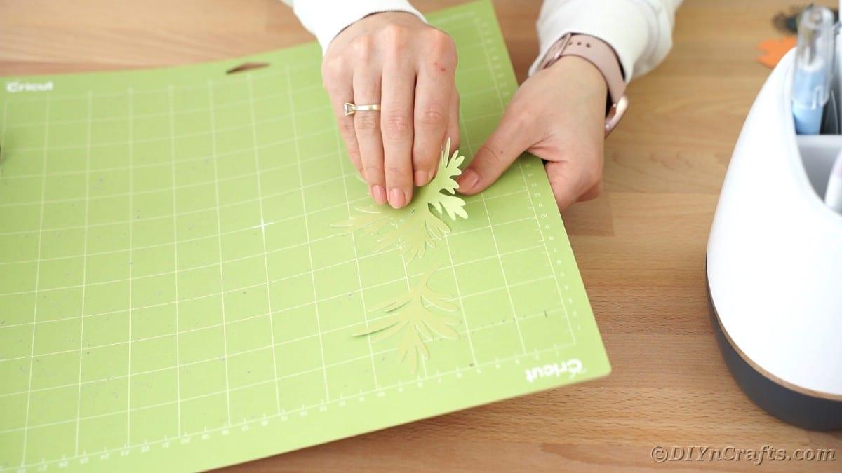 Peeling leaves off of Cricut mat