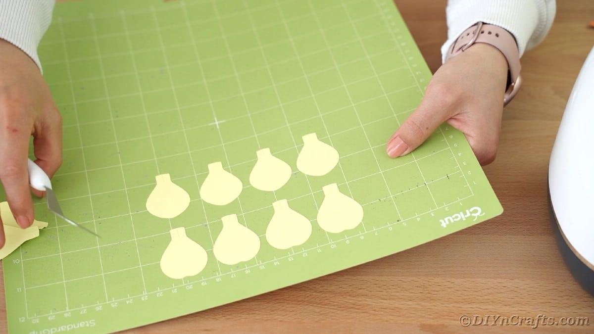 Yellow petal shapes on Cricut mat