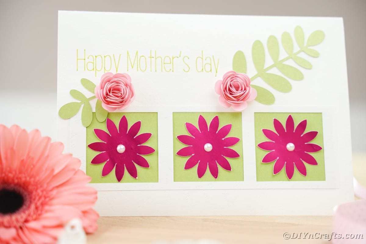 White mothers day card with green and pink flowers