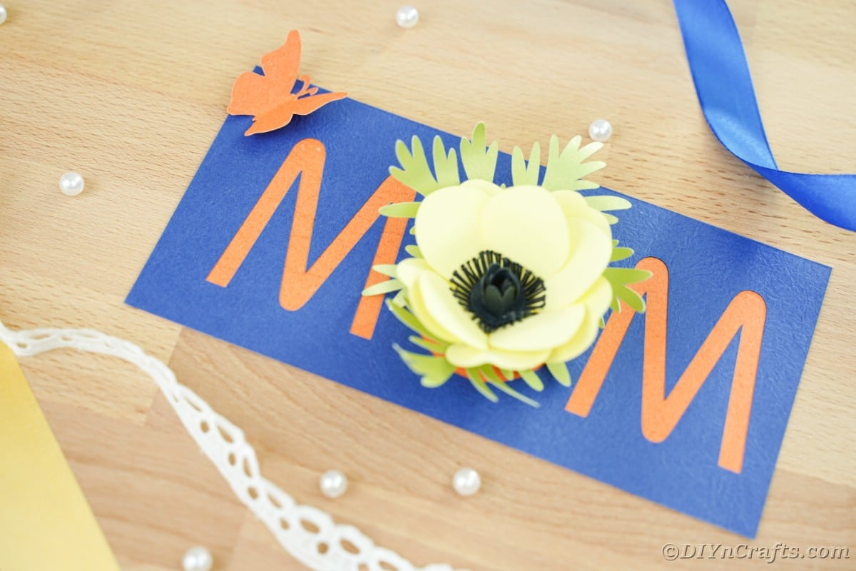 Mom card with blue and orange and yellow flower