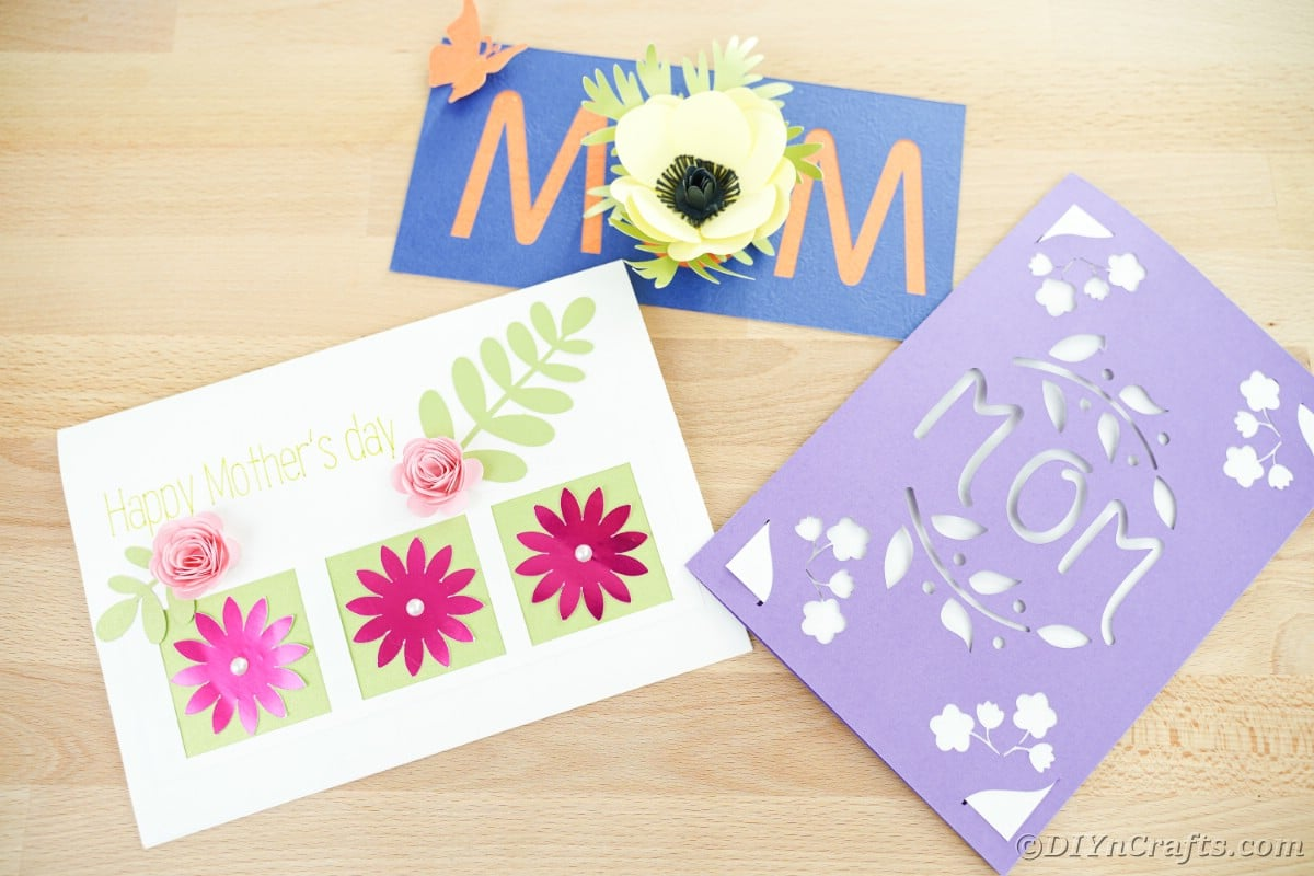 Three mothers day cards on wooden table