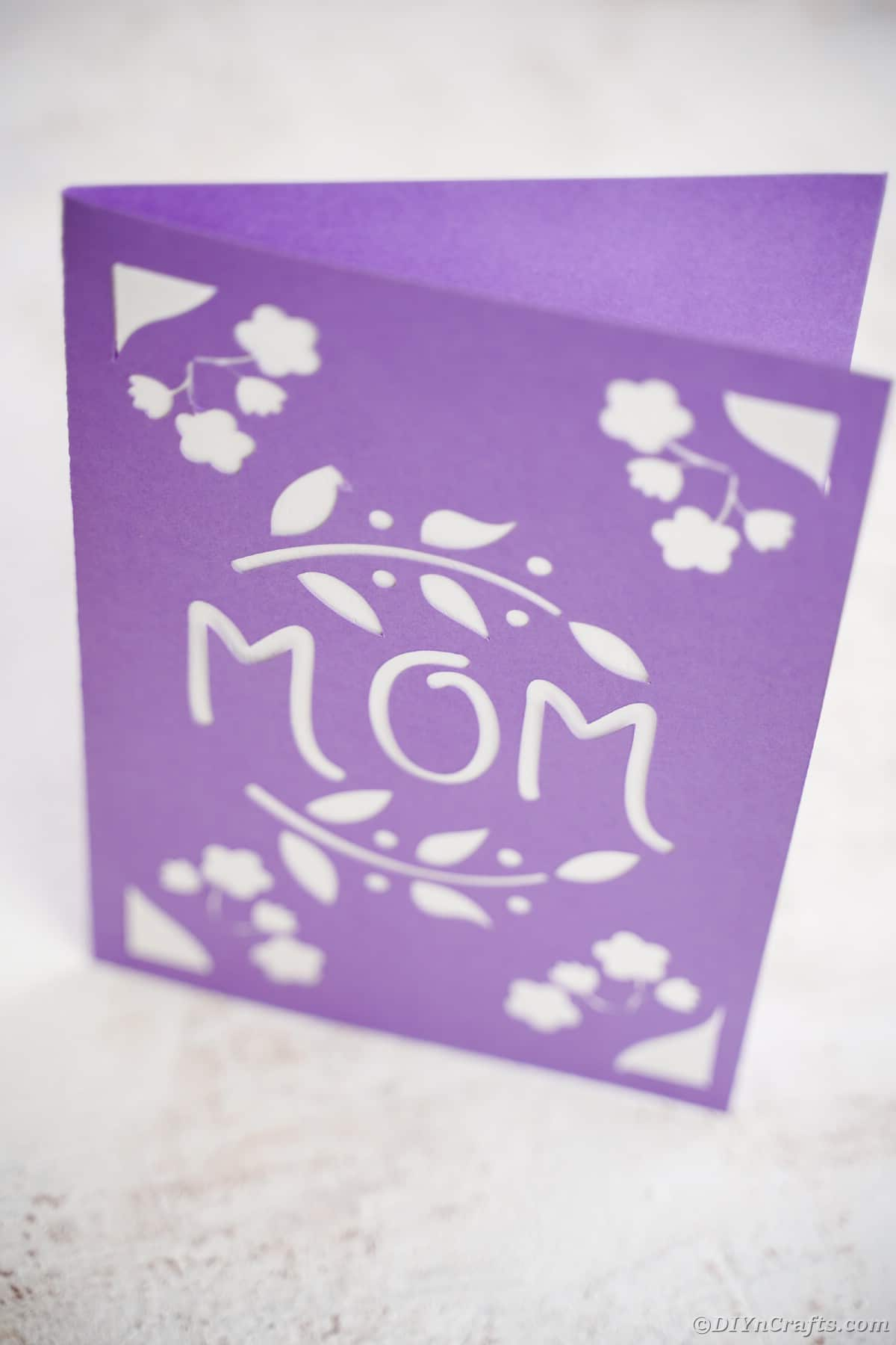Purple and white card with mom and flowers