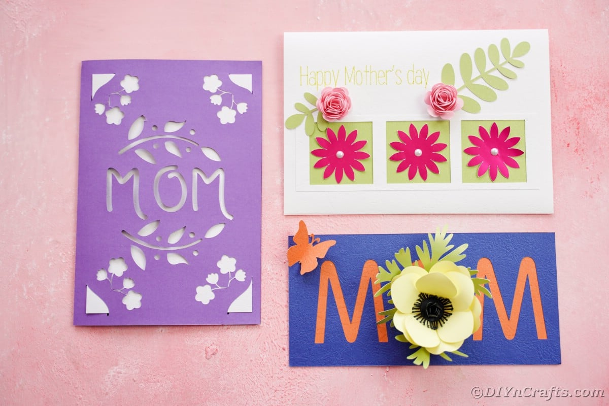 Three mothers day cards on pink table