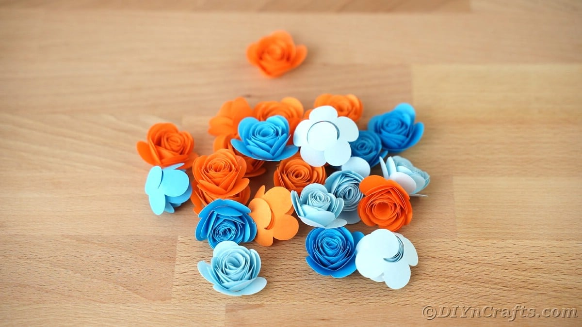 Paper flowers on wooden table