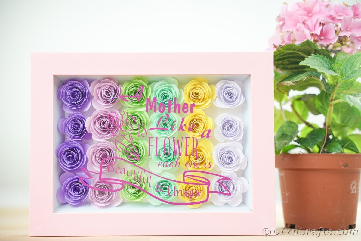 Mother's Day shadowbox next to terra cotta flower