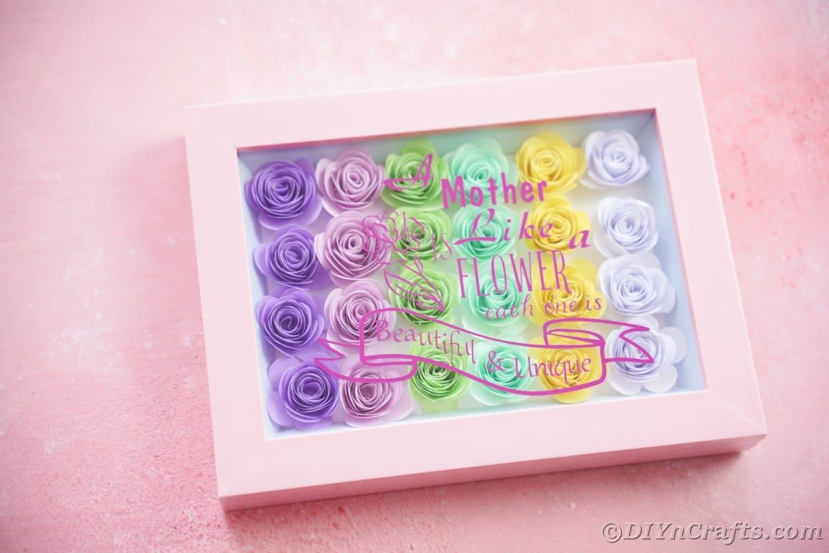 Colorful pink shadow box on pink paper