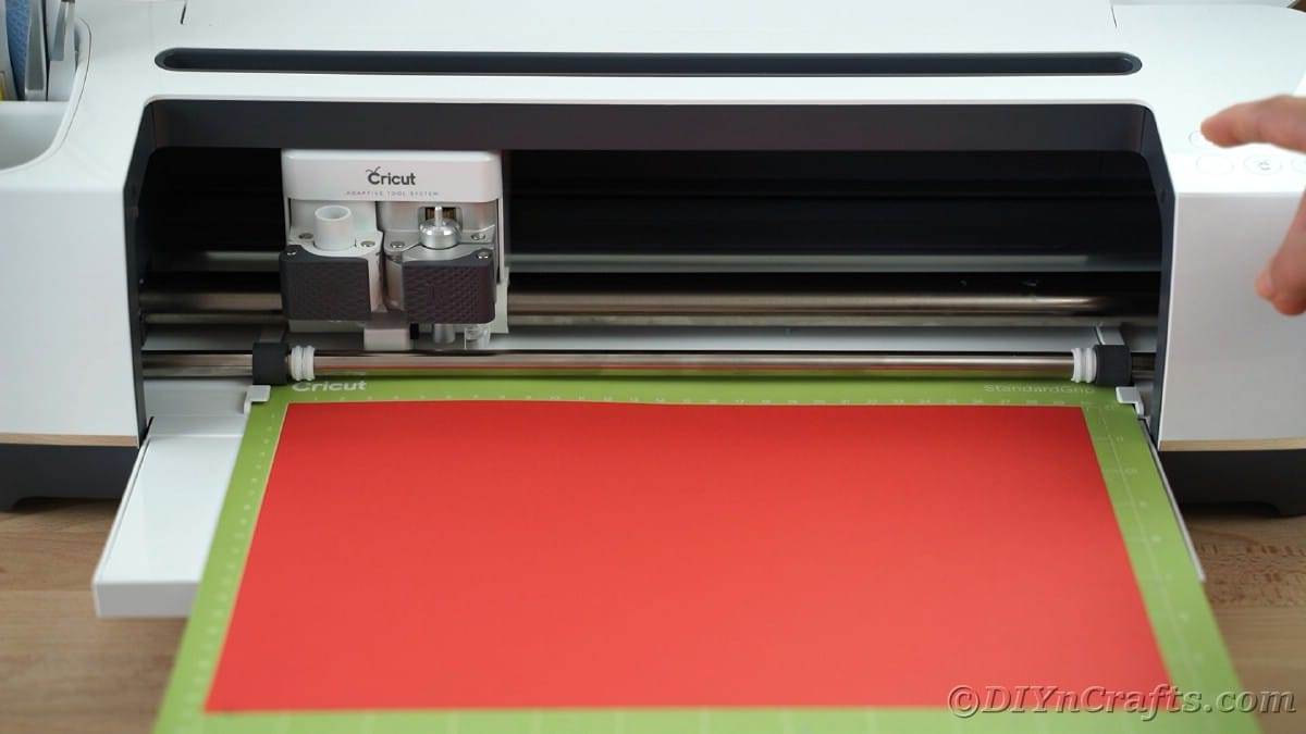 Loading paper on mat of Cricut
