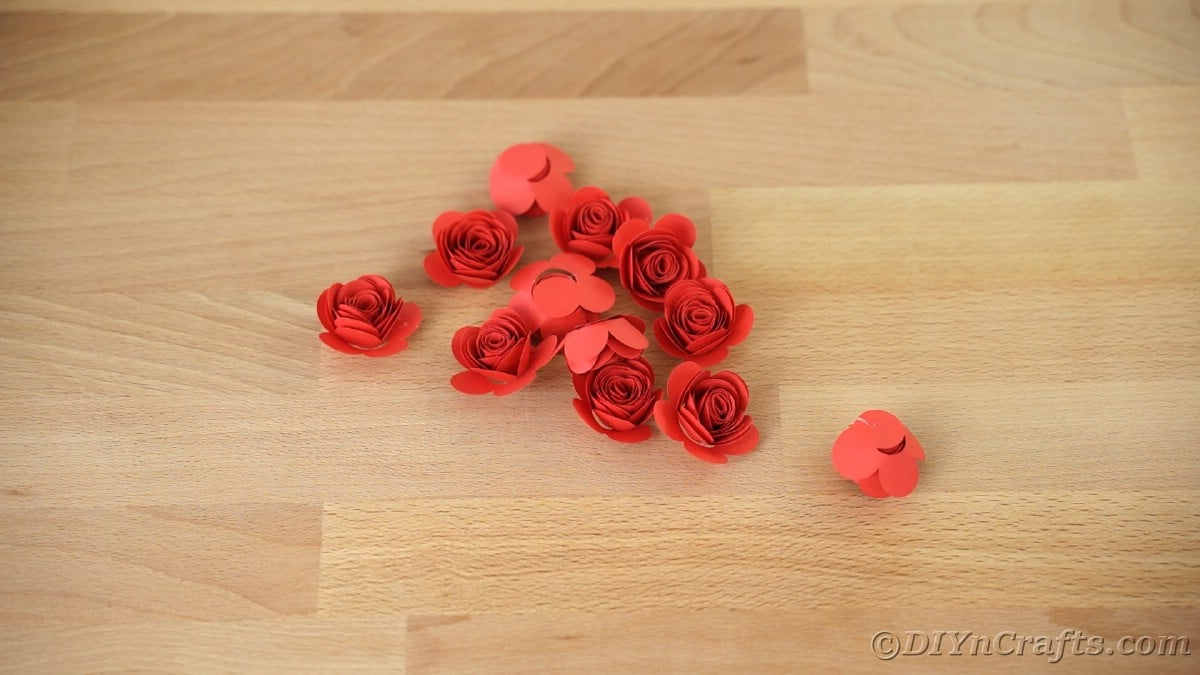 Pile of red paper flowers on table