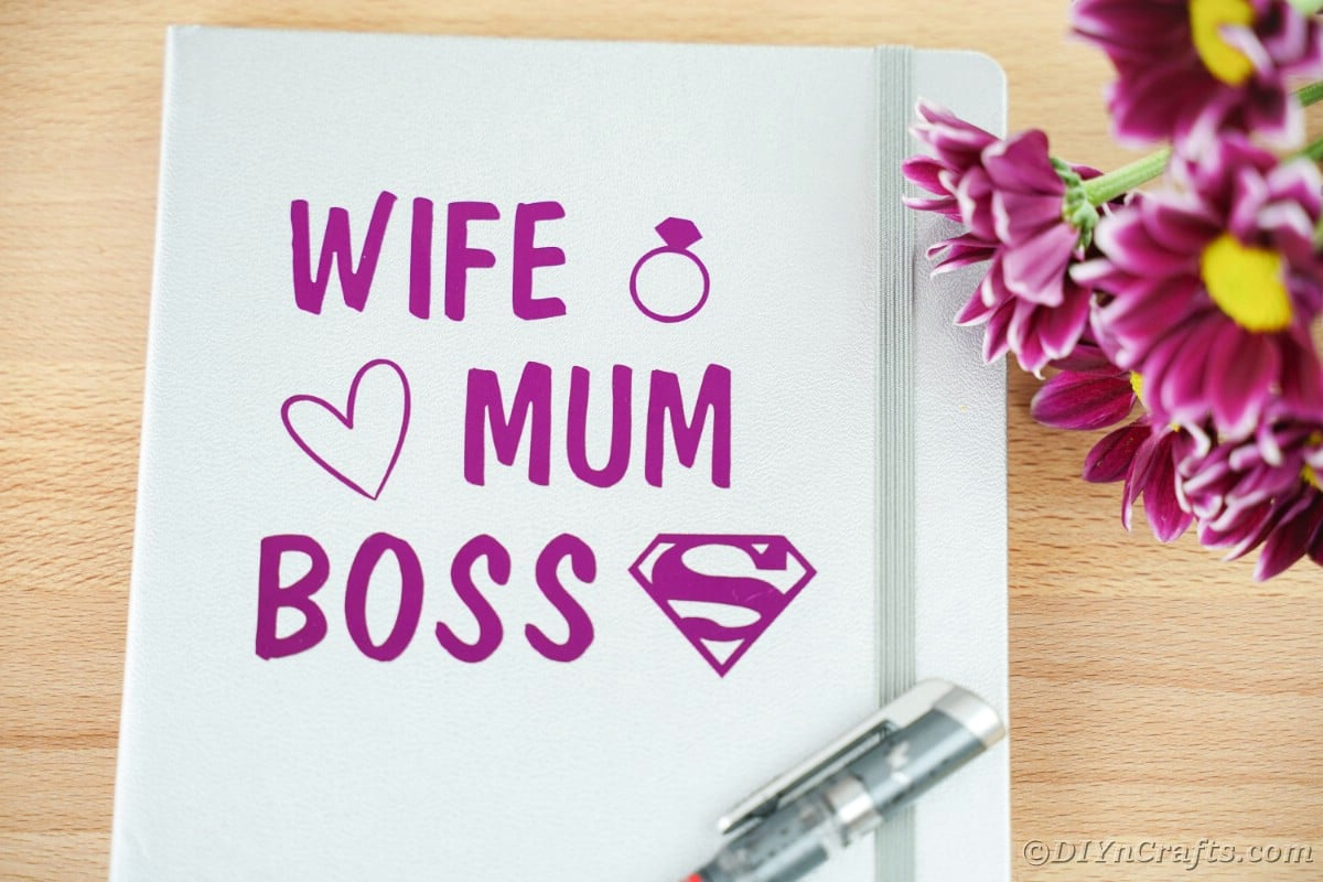 Close up of purple wife mum boss message on gray notebook