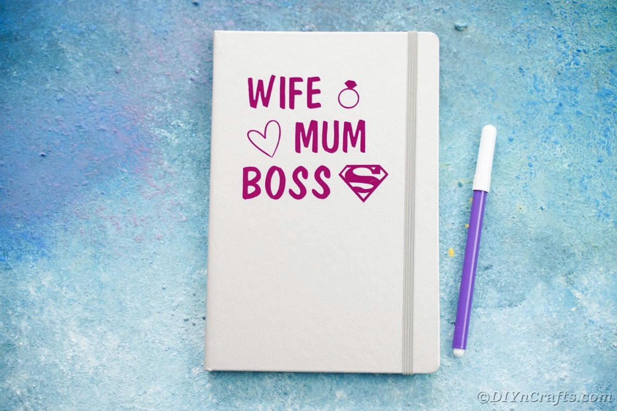 Wife mum boss written on gray book on blue table