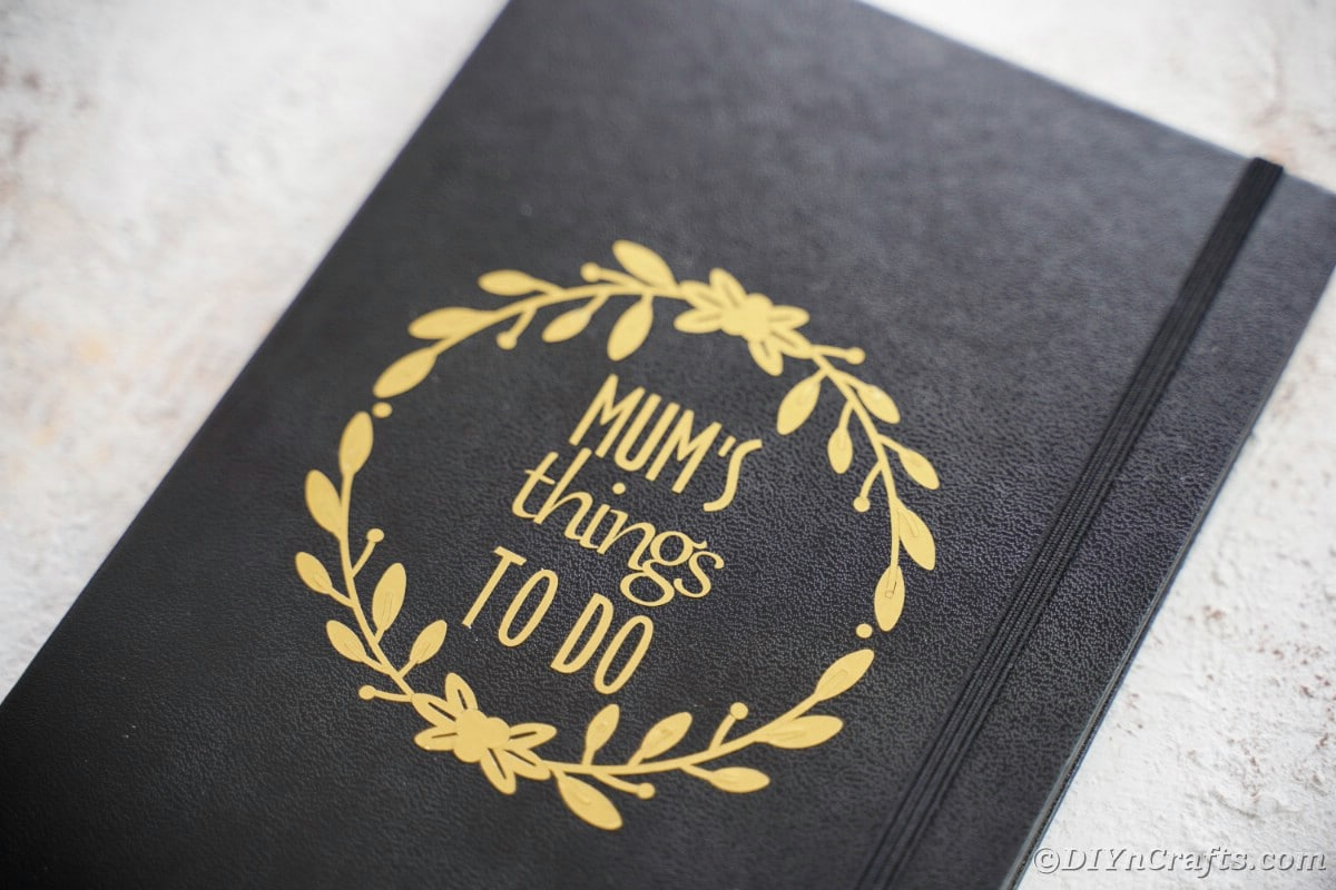 Mums things to do in gold on black notebook