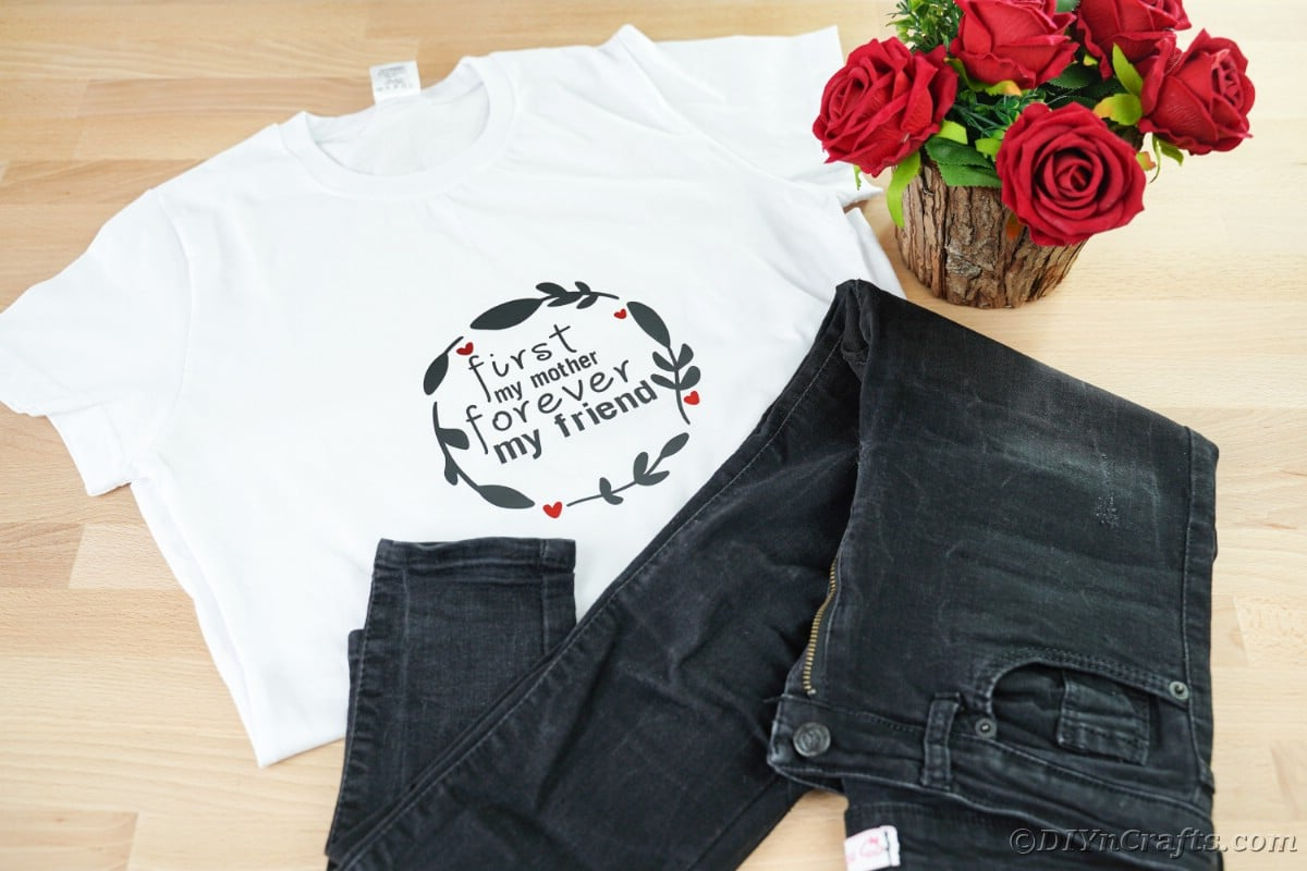 White mothers day shirt on table with black jeans