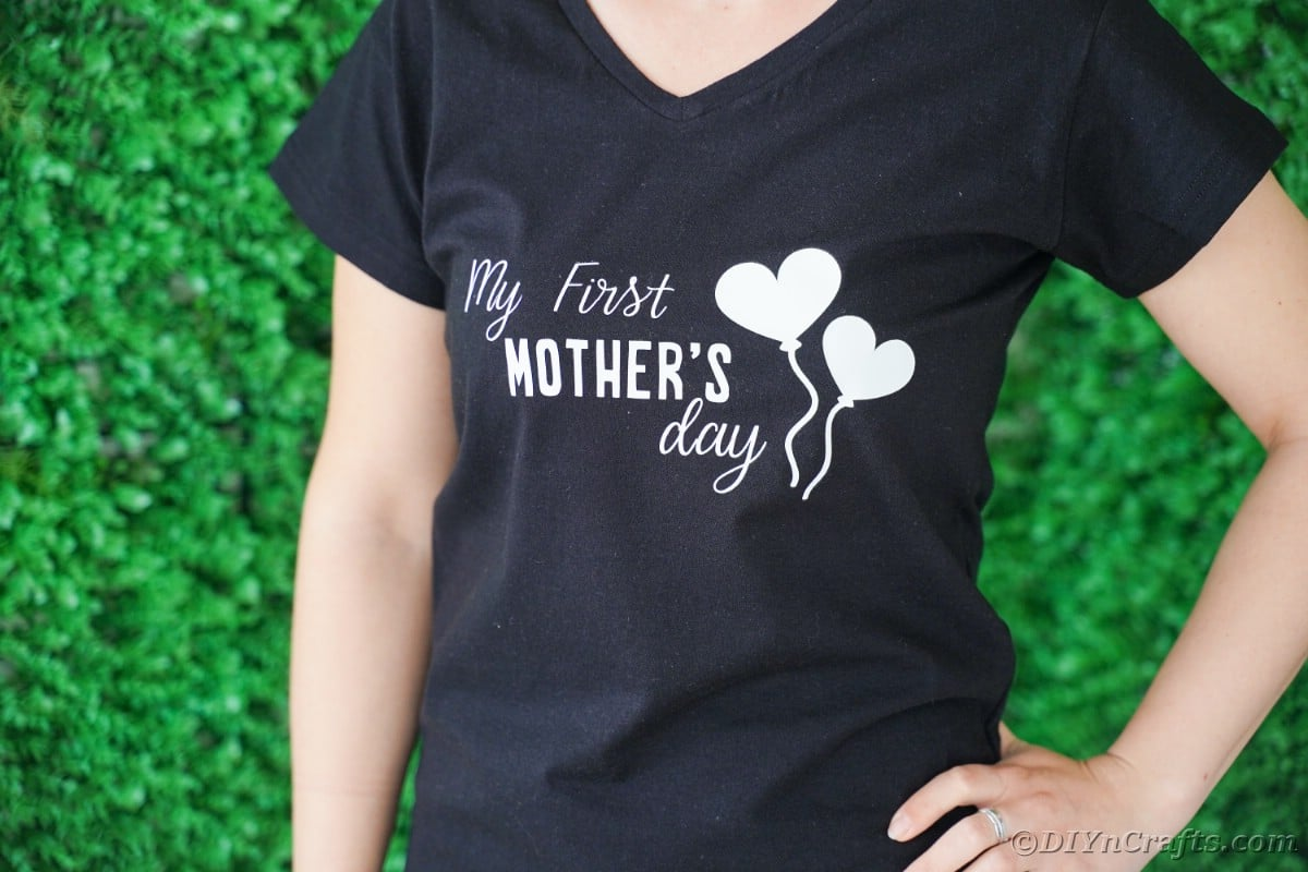 Woman with and on hip with black tshirt