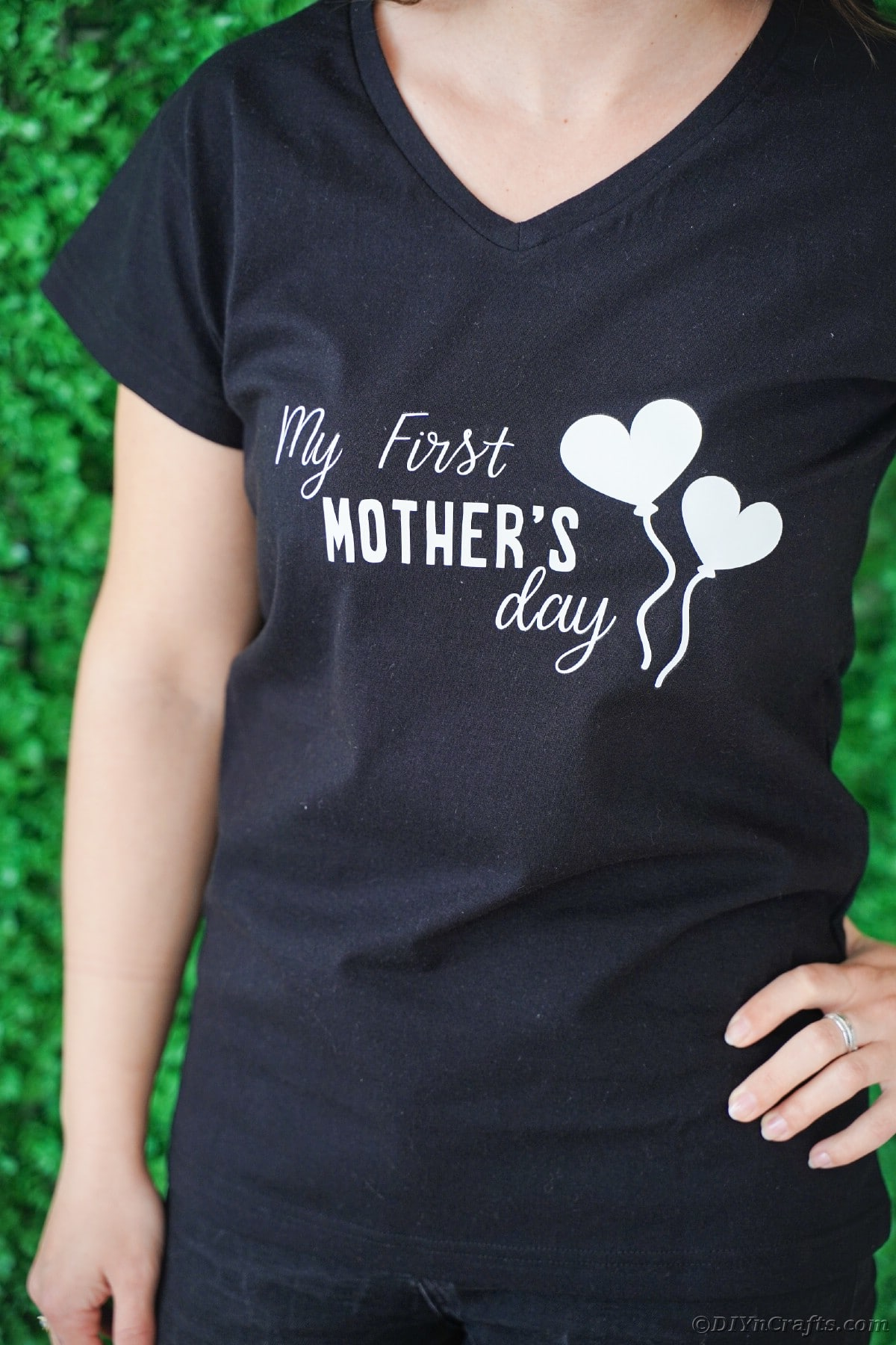 Woman wearing black first mothers day tshirt