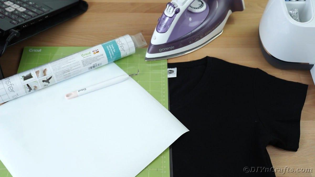 Iron with Cricut mat and black tshirt