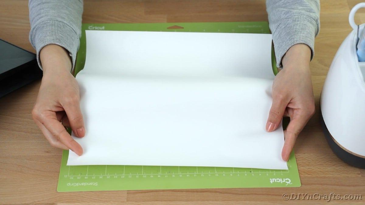 Spreading vinyl on Cricut mat