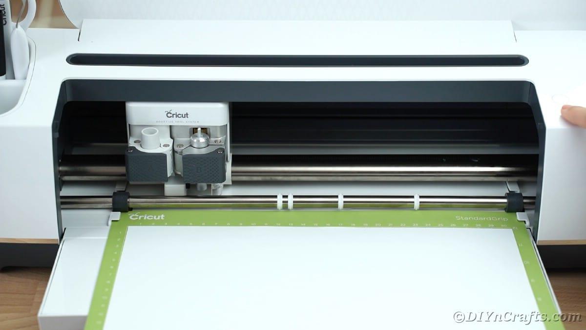 Loading vinyl onto Cricut mat