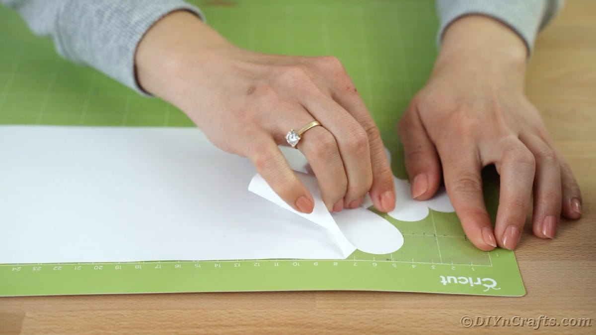 Peeling excess vinyl off of Cricut mat