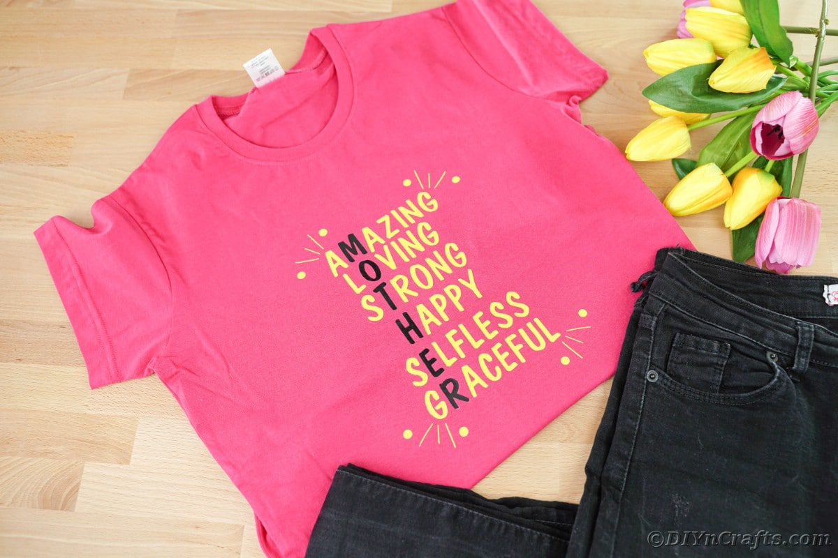 Pink tshirt next to black jeans
