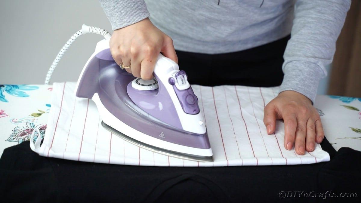 Ironing vinyl onto black tshisrt