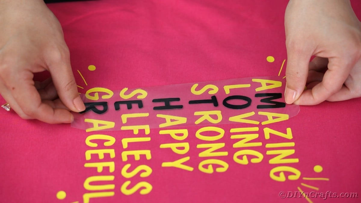 Placing black letters between yellow letters on tshirt