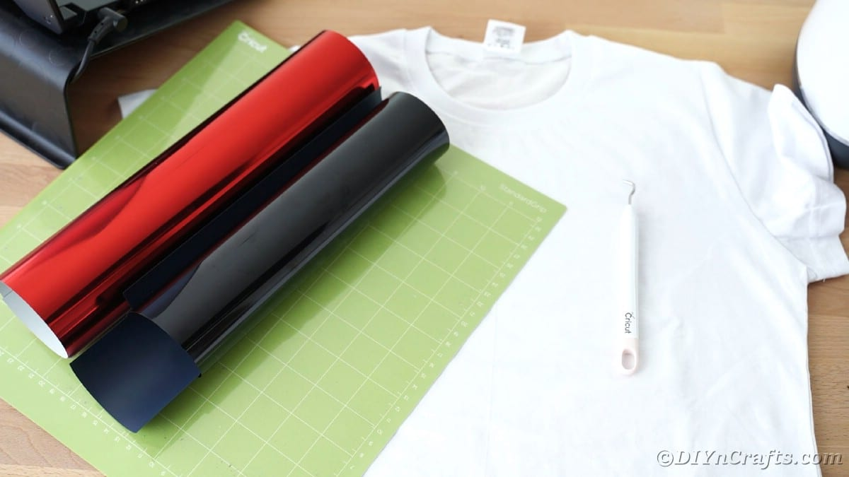 Rolls of black and red vinyl on Cricut mat