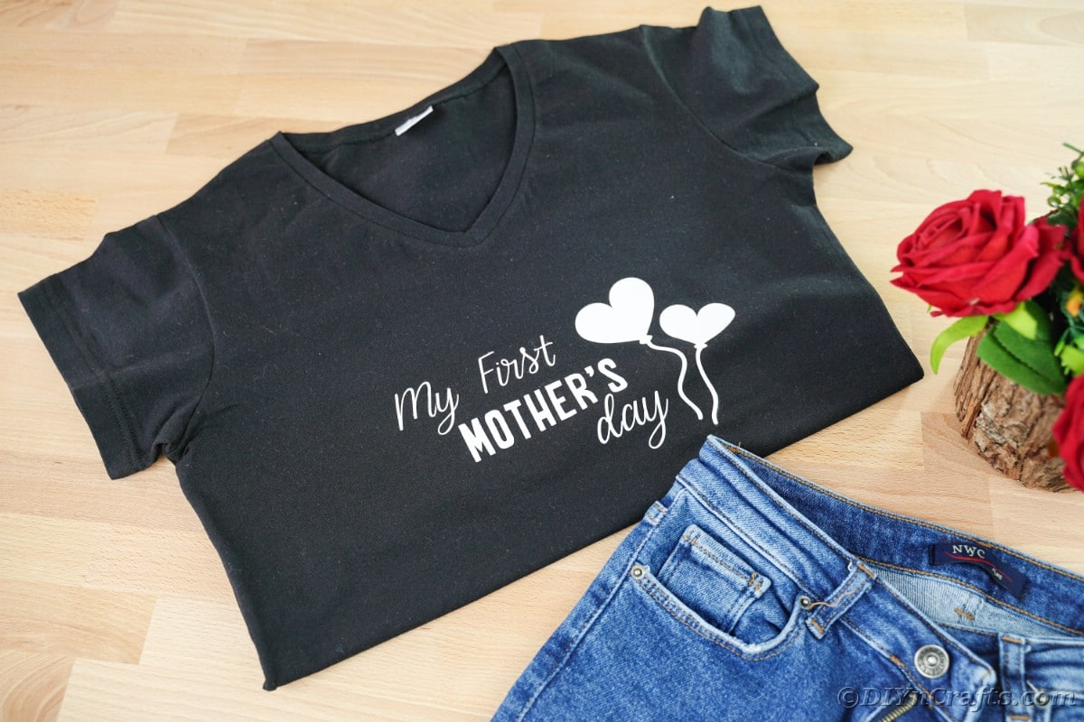 Black Mothers day shirt by jeans on table