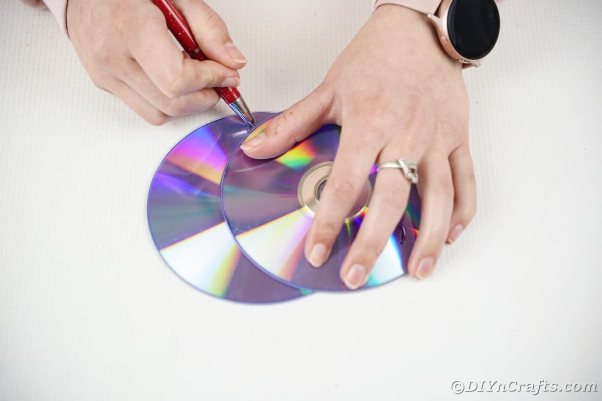 Tracing a moon shape onto a CD