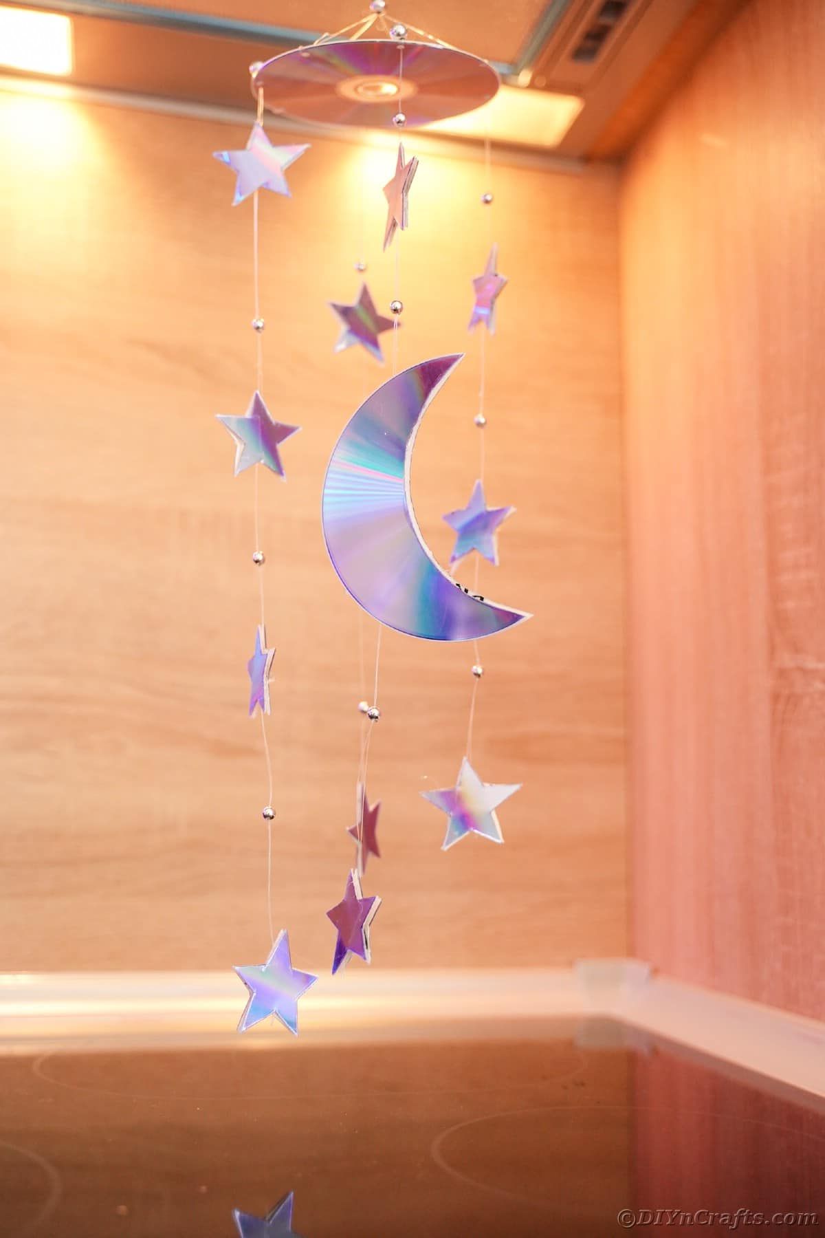 Mobile hung from ceiling in front of wooden walls