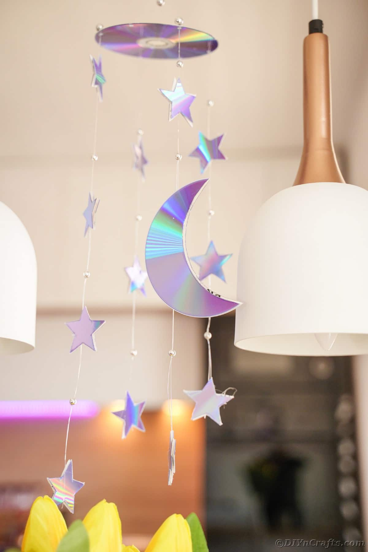 Mobile hanging from ceiling by white lamp
