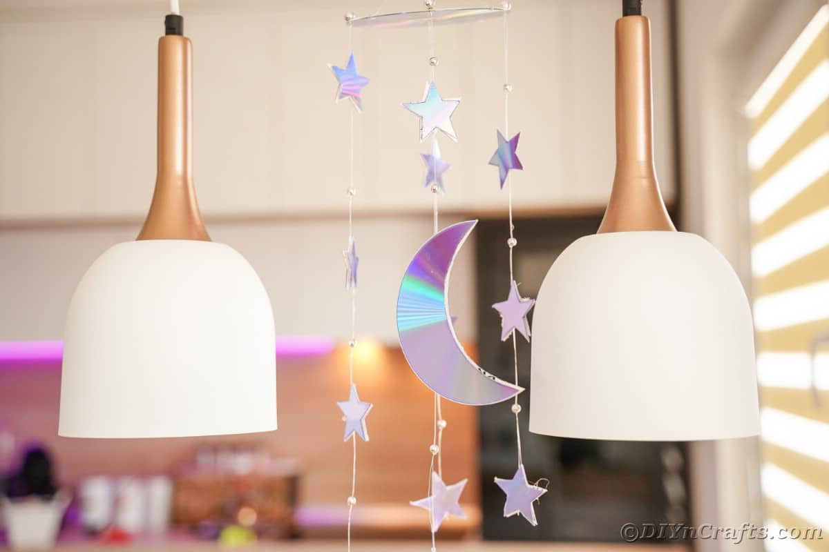 Mobile hanging from ceiling with stars and moon shapes