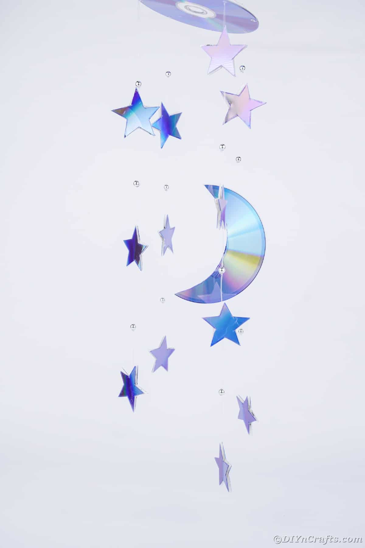 Stars and moon mobile against white wall