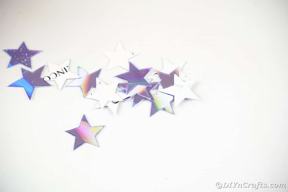 CD stars in pile on white counter